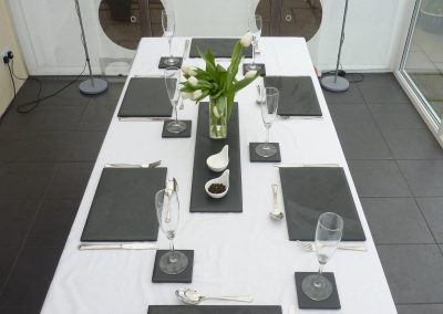 dining table with slate placemats and coasters